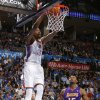 Oklahoma City\'s Kevin Durant (35) dunks the ball beside Los Angeles\' Metta World Peace (15) during an NBA basketball game between the Oklahoma City Thunder and the Los Angeles Lakers at Chesapeake Energy Arena in Oklahoma City, Thursday, Feb. 23, 2012. Oklahoma City won 100-85. Photo by Bryan Terry, The Oklahoman