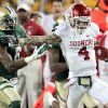 Oklahoma\'s Kenny Stills (4) catches long pass and is run out of bounds by Baylor\'s Ahmad Dixon (6) during the college football game between the University of Oklahoma Sooners (OU) and the Baylor Bears (BU) at Floyd Casey Stadium on Saturday, Nov. 19, 2011, in Waco, Texas. Photo by Steve Sisney, The Oklahoman