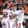 Oklahoma\'s Landry Jones (12) and Oklahoma\'s James Hanna (82) celebrate after the Bedlam college football game between the University of Oklahoma Sooners (OU) and the Oklahoma State University Cowboys (OSU) at Boone Pickens Stadium in Stillwater, Okla., Saturday, Nov. 27, 2010. Photo by Bryan Terry, The Oklahoman
