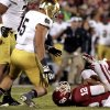 Oklahoma quarterback Landry Jones (12) lies on the ground after being sacked during the first half of the college football game between the University of Oklahoma Sooners (OU) and the Fighting Irish of Notre Dame (ND) at Gaylord Family-Oklahoma Memorial Stadium in Norman, Okla., on Saturday, Oct. 27, 2012. Photo by Steve Sisney, The Oklahoman