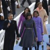 President Barack Obama, first lady Michelle Obama and Malia and Sasha Obama and Michelle Obama\'s mother Marian Robinson walk down to the Presidential reviewing stand in front of the White House, Monday, Jan. 21, 2013, in Washington. Thousands marched during the 57th Presidential Inauguration parade after the ceremonial swearing-in of President Barack Obama. (AP Photo/Charlie Neibergall ) ORG XMIT: DCMS1