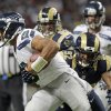 Seattle Seahawks\' Russell Wilson (3) is sacked by St. Louis Rams\' Eugene Sims (92) during the first half of an NFL football game Sunday, Sept. 30, 2012, in St. Louis. (AP Photo/Seth Perlman)