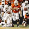 Blake Gideon (21) of Texas chases an OSU fumble in the second quarter as OSU\'s Andrew Lewis (54) and Hubert Anyiam (84) look on during the college football game between the Oklahoma State University Cowboys (OSU) and the University of Texas Longhorns (UT) at Boone Pickens Stadium in Stillwater, Okla., Saturday, Oct. 31, 2009. Texas recovered the fumble. Photo by Nate Billings, The Oklahoman