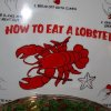 FESTIVE LOBSTER LUNCH...Place mats give lobster eating instructions. (Photo by Helen Ford Wallace).