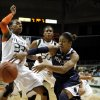 Penn State\'s Dara Taylor makes the pass as Miami\'s Suriya McGuire, left, defends during the first half of an NCAA women\'s college basketball game in Miami, Thursday, Nov. 29, 2012. (AP Photo/Jeffrey M. Boan)