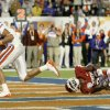 Florida\'s David Nelson scores a touchdown in front of OU\'s Keenan Clayton, center, and Quinton Carter during the second half of the BCS National Championship college football game between the University of Oklahoma Sooners (OU) and the University of Florida Gators (UF) on Thursday, Jan. 8, 2009, at Dolphin Stadium in Miami Gardens, Fla. PHOTO BY BRYAN TERRY, THE OKLAHOMAN