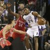 Sacramento Kings forward Jason Thompson, right, tries to work out of the double team of Houston Rockets\' Jeremy Lin, left, and Patrick Patterson, center during the first quarter of an NBA basketball game in Sacramento, Calif., Sunday, Feb. 10, 2013.(AP Photo/Rich Pedroncelli)