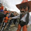 Pistol Pete interacts with the Oklahoma State fans while in the \'Spirit Walk\' before the Bedlam college football game between the Oklahoma State University Cowboys (OSU) and the University of Oklahoma Sooners (OU) at Boone Pickens Stadium in Stillwater, Okla., Saturday, Dec. 3, 2011. Photo by Chris Landsberger, The Oklahoman