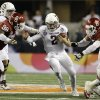 Texas A&M quarterback Johnny Manziel (2) runs between Oklahoma\'s Chuka Ndulue (98) and R.J. Washington during the second half of the Cotton Bowl NCAA college football game Friday, Jan. 4, 2013, in Arlington, Texas. (AP Photo/Tony Gutierrez)