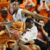 Texas\' Myck Kabongo (12) tries to get past Oklahoma State\'s Markel Brown (22) during an NCAA college basketball game between Oklahoma State University (OSU) and the University of Texas (UT) at Gallagher-Iba Arena in Stillwater, Okla., Saturday, Feb. 18, 2012. Oklahoma State won 90-78. Photo by Bryan Terry, The Oklahoman