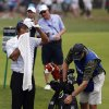 Photo - Tiger Woods wipes his face on the 10th hole during the second round of the PGA Championship golf tournament at Valhalla Golf Club on Friday, Aug. 8, 2014, in Louisville, Ky. (AP Photo/Mike Groll)