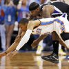 Oklahoma City\'s Russell Westbrook (0) and Sacramento\'s DeMarcus Cousins (15) chase a loose ball during an NBA basketball game between the Oklahoma City Thunder and the Sacramento Kings at Chesapeake Energy Arena in Oklahoma City, Monday, April 15, 2013. Photo by Nate Billings, The Oklahoman