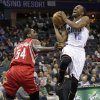 Charlotte Bobcats\' Kemba Walker (15) drives past Houston Rockets\' Patrick Patterson (54) during the first half of an NBA basketball game in Charlotte, N.C., Monday, Jan. 21, 2013. (AP Photo/Chuck Burton)