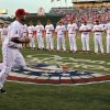 Los Angeles Angels\' Albert Pujols runs out during introductions prior to a baseball game against the Kansas City Royals, Friday, April 6, 2012, in Anaheim, Calif. (AP Photo/Mark J. Terrill)