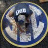 Photo - In this May 23, 2014 photo, John Wagnon, of Florida, cleans the SEC logo before a game at the Southeastern Conference NCAA college baseball tournament in Hoover, Ala. A 40-man grounds crew labored to keep Hoover Met's field in good shape for the six-day, 17-game tournament. (AP Photo/Butch Dill)