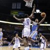 Photo -   Denver Nuggets guard Arron Afflalo (6) shoots as Oklahoma City Thunder forward Serge Ibaka (9) defends during the first quarter of an NBA basketball game in Oklahoma City, Wednesday, April 25, 2012. (AP Photo/Sue Ogrocki)