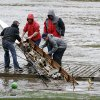 Members of the Saint Joseph\'s University crew team pull a damaged boat from the Schuylkill river in the wake of superstorm Sandy, Tuesday, Oct. 30, 2012, in Philadelphia. A one-two punch of rain and high wind from a monster hybrid storm that started out as a hurricane battered Pennsylvania, leaving more than a million customers without power as officials began assessing the damage Tuesday. (AP Photo/Matt Slocum) ORG XMIT: PAMS104