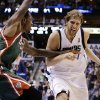 Milwaukee Bucks\' Larry Sanders, left, defends Dallas Mavericks\' Dirk Nowitzki during the second half of an NBA basketball game Tuesday, Feb. 26, 2013, in Dallas. The Bucks won 95-90. (AP Photo/Tony Gutierrez)