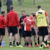 Photo - Belgium's head coach Marc Wilmots, center, talks with his players during a training session of Belgium in Mogi Das Cruzes, Brazil, Thursday, June 19, 2014. Belgium play in group H of the 2014 soccer World Cup. (AP Photo/Andrew Medichini)