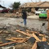 Photo -  Debris was scattered across a northwest Oklahoma City neighborhood near NW 122 and N Council Road early Saturday when a home exploded and sent three people to a hospital. [PHOTO BY PAUL HELLSTERN, THE OKLAHOMAN]