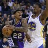 Sacramento Kings\' Isaiah Thompson, left, drives the ball against Golden State Warriors\' Harrison Barnes during the first half of an NBA basketball game Wednesday, March 6, 2013, in Oakland, Calif. (AP Photo/Ben Margot)