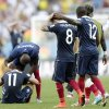 Photo - France's Rio Mavuba walks off the pitch with his teammate Mathieu Valbuena (8) after Germany defeated France 1-0 to advance to the semifinals during the World Cup quarterfinal soccer match at the Maracana Stadium in Rio de Janeiro, Brazil, Friday, July 4, 2014. Left is France's Eliaquim Mangala and Antoine Griezmann. (AP Photo/Matthias Schrader)