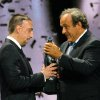 Photo - UEFA President Michel Platini, right, gives the trophy for  best player of the year to Franck Ribery, midfielder of FC Bayern Munich, during the UEFA Champions League draw, at the Grimaldi Forum, in Monaco, Thursday, Aug. 29, 2013. (AP Photo/Claude Paris)