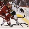 Phoenix Coyotes\' Derek Morris (53) gets the puck as Chicago Blackhawks\' Brandon Saad (20) loses his stick during the first period in an NHL hockey game Thursday, Feb. 7, 2013, in Glendale, Ariz.(AP Photo/Ross D. Franklin)