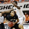 Photo -   Portland State guard Gary Winston (14) is fouled by Oklahoma State guard Kirby Gardner (1) in the first half of an NCAA college basketball game in Stillwater, Okla., Sunday, Nov. 25, 2012. (AP Photo/Sue Ogrocki)