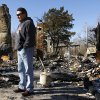 Photo - Chris Cochran stands among the charred rubble that was his  family's home in a rural area near Cashion until it was destroyed in a recent fire.  His son, Cayden Cochran, a star player when he attended Cashion High School, is now starting quarterback at Division II power Valdosta State, and this weekend, he leads Valdosta into the Division II national championship game. Photo taken Wednesday, Dec. 12, 2012.    Photo by Jim Beckel, The Oklahoman  Jim Beckel - THE OKLAHOMAN