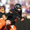 Photo - Oklahoma State quarterback J.W. Walsh runs during the second half of an NCAA football game against Kansas State in Stillwater, Okla., Saturday, Oct. 5, 2013. Oklahoma State won 33-29. (AP Photo/Brody Schmidt)