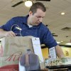 a Jason\'s employee checks an order before delivering it. Photo by Tiffany Gibson, The Oklahoman