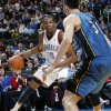 Oklahoma City\'s Kevin Durant (35) looks to drive the ball past Yi Jianlian (31) of Washington during the NBA basketball game between the Washington Wizards and the Oklahoma City Thunder at the Oklahoma City Arena in Oklahoma City, Friday, January 28, 2011. Photo by Nate Billings, The Oklahoman