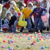 Children race to pick up plastic eggs during OKC Egg Drop, Northview Community Church\'s Easter egg hunt, at Harvest Hills Park in Oklahoma City, Saturday, April 11, 2009. Photo by Nate Billings, The Oklahoman