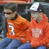 Six year olds Talon Kendrick (left) and Nathan Stevens watch the Oklahoma State Cowboy\'s homecoming parade in downtown Stillwater, OK, Saturday, Oct. 29, 2011. By Paul Hellstern, The Oklahoman