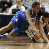 Photo - Connecticut's Moriah Jefferson, right, steals the ball from Memphis' Devin Mack, left, during the first half of an NCAA college basketball game, Wednesday, Jan. 22, 2014, in Hartford, Conn. (AP Photo/Jessica Hill)