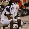 A West Virginia player sits dejected on the bench following a college football game between the University of Oklahoma Sooners (OU) and the West Virginia University Mountaineers at Gaylord Family-Oklahoma Memorial Stadium in Norman, Okla., on Saturday, Sept. 7, 2013. Photo by Steve Sisney, The Oklahoman
