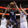 Photo - Charlotte Bobcats' Michael Kidd-Gilchrist (14) shoots over Philadelphia 76ers' Spencer Hawes (00) and Evan Turner (12) during the first half of an NBA basketball game, Saturday, Feb. 9, 2013, in Philadelphia. (AP Photo/Michael Perez)