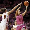 Oklahoma\'s Morgan Hook (10) takes the ball to the hoop past Iowa State\'s Hallie Christofferson (5) and Nicole