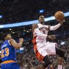 Photo - Toronto Raptors' Terrence Ross goes to the basket past New York Knicks' Toure' Murry during the first half of an NBA basketball game in Toronto on Saturday, Dec. 28, 2013. (AP Photo/The Canadian Press, Chris Young)