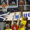 West Virginia\'s Aaric Murray (24) shoots over Radford\'s Lucas Dyer (15) during the first half of an NCAA college basketball game at WVU Coliseum in Morgantown, W.Va., on Saturday, Dec. 22, 2012. (AP Photo/David Smith)