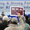 Supporters hold signs during a rally for Democratic Party candidates at River\'s Edge Convention Center in St. Cloud, Minn., Saturday, Nov. 3, 2012. (AP Photo/The St. Cloud Times, Dave Schwarz) NO SALES