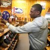 Photo -  Jim Thorpe Award winner Morris Claiborne looks for a pair of boots at Tener's Western Outfitters in Oklahoma City, Monday, February  6, 2012. Tener's gives the recipient of the Jim Thorpe Award a pair of cowboy boots and hat each year. Photo By Steve Gooch, The Oklahoman