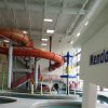 In this March 27, 2014 photo an oil derrickand the flames of gas fires decorate an indoor water park at a new recreation center in oil-rich Williston, North Dakota. The city hopes the center will help draw families to North Dakota\'s oil patch. (AP Photo/Josh Wood)