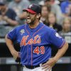 Photo - New York Mets pitcher Jonathon Niese reacts after being hit by a line drive in the first inning against the Texas Rangers during baseball game on Friday, July 4, 2014, in New York. Niese left the game and was replaced by Carlos Torres. (AP Photo/Julie Jacobson)