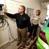 Dan Reeves of Landmark Fine Homes and Pam Hall of Oklahoma Natural Gas fill a CNG vehicle in the garage at this model home, 4500 Northfields, a concept home that uses Compressed Natural Gas, as well as other features on Friday, April 5, 2013 in Norman, Okla. Photo by Steve Sisney, The Oklahoman