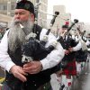 Photo - Snow accumulates on the beard of a bagpipe player in the Wyoming Valley Pipe and Drum Band as they perform in the Wilkes-Barre St. Patrick's Day parade in Wilkes-Barre, Pa., Saturday, March 16, 2013.   St. Patrick's Day Parade. (AP Photo/The Citizens' Voice, Kristen Mullen)