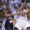 Oklahoma City\'s Kevin Durant (35) looks to pass the ball as Tony Allen (9) of Memphis and Sam Young (4) defend him during game five of the Western Conference semifinals between the Memphis Grizzlies and the Oklahoma City Thunder in the NBA basketball playoffs at Oklahoma City Arena in Oklahoma City, Wednesday, May 11, 2011. Photo by Sarah Phipps, The Oklahoman
