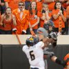 OSU fans watch as Oklahoma State\'s Charlie Moore (17) catches a touchdown pass against West Virginia\'s Pat Miller (6) in the third quarter during a college football game between Oklahoma State University (OSU) and West Virginia University (WVU) at Boone Pickens Stadium in Stillwater, Okla., Saturday, Nov. 10, 2012. OSU won, 55-34. Photo by Nate Billings, The Oklahoman