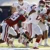 Oklahoma\'s Mossis Madu (17) runs past Stanford\'s Harold Bernard (28) during the first half of the Brut Sun Bowl college football game between the University of Oklahoma Sooners (OU) and the Stanford University Cardinal on Thursday, Dec. 31, 2009, in El Paso, Tex. Photo by Chris Landsberger, The Oklahoman